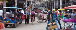 resa runt delhi panorama 300x120 - New Delhi, India - JULY 18 2018: Busy street in New Delhi, India. Rickshaws,  motorcycles and conges